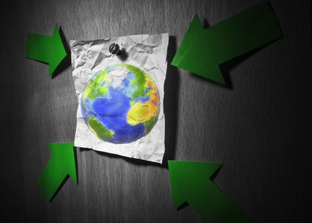 Conceptual environment image. Earth pined to wall on a crumpled paper and pointed by green arrows. Earth is a garbage concept