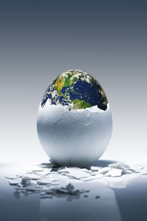 Creative conceptual image.Planet Earth birth from egg.