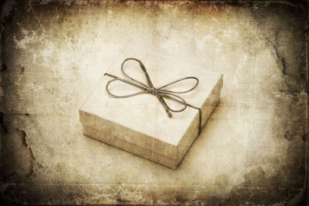 winter gift: Grunge style gift box mixed with old texture. Awe vibrant color festive vintage image Stock Photo