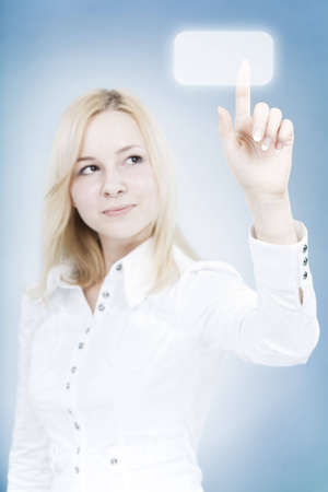 Young businesswoman touching a virtual button. Conceptual business image. Stock Photo - 4610435