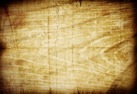 Aged grunge texture mixed background with scratches, stains and dark borders. Beautiful vintage brown vibrant colors