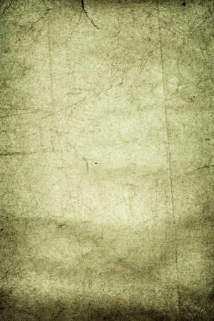 pinchers: Green creepy grunge paper background with folds and pinchers