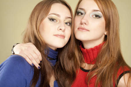 Two teenage beautiful careful girls embrace each other. Love, family concept Stock Photo - 5948435
