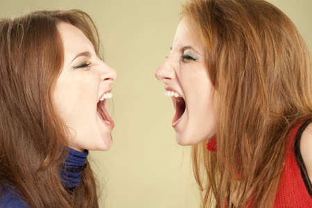 Two teenage girls screaming to each other Stock Photo