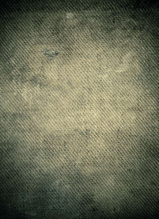 Spooky dark stained burlap background with dark borders end empty space in center