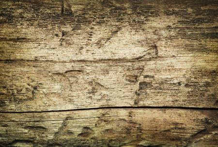 Wooden grunge fissured background damaged by parasites Stock Photo