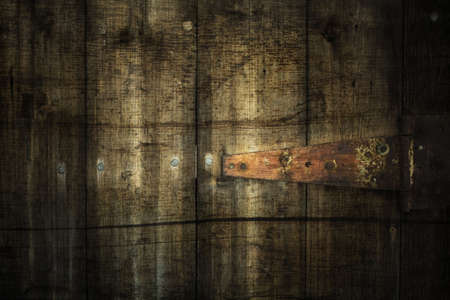Dirty grunge awe stained backdrop with dark borders and rusty metal part photo