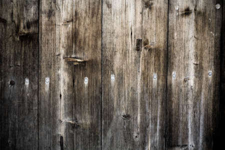 Desaturated grunge weathered torn wooden planks background