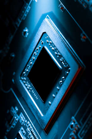 Dark high technology electronics computer component illuminated by spot of light. Innovation concept Stock Photo