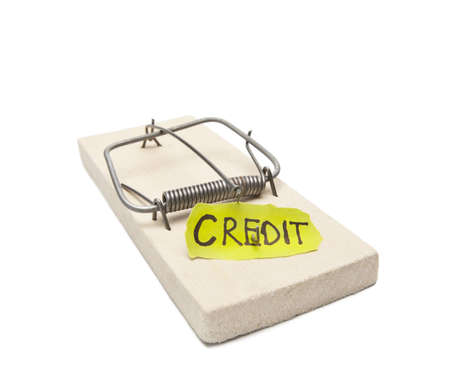 Mousetrap with bait credit inside  Debtor s prison concept image  Object on white, focus on inscription