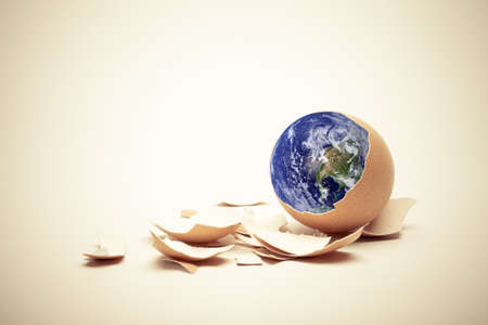Planet Earth on egg with shell  Conceptual Easter image  Earth in this montage provided by NASA  http   visibleearth nasa gov   photo