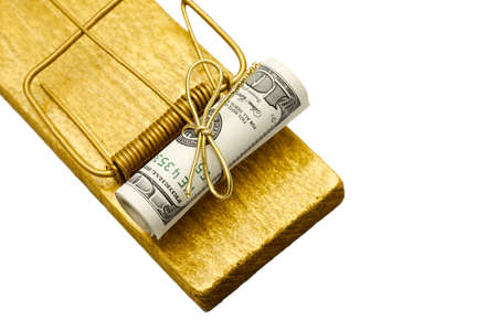 Focus on money  Golden mousetrap with rolled dollar bait  Free money, risk in business, temptation, gift concept photo
