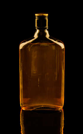 whiskey bottle: Isolated with clipping paths single bottle of whisky with reflection  Warm colors image Stock Photo