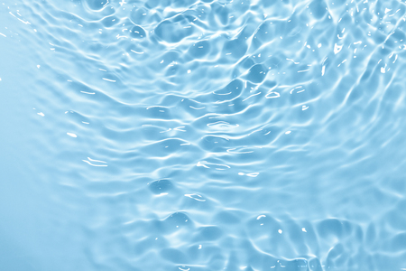 Blue water in sun lights background