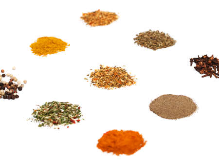 Spices set on white. Individual seasonings and mixes thereof. Low aperture shot, selective focus