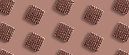 Square wafer cake with chocolate pattern, sweet flat lay, creative food texture Foto de archivo