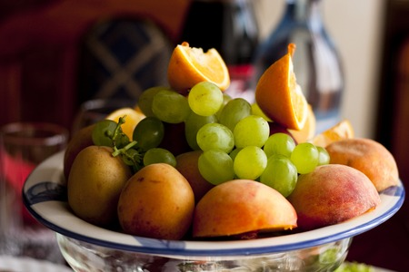 fruit on a plate, bananas, grapes, apples, photo