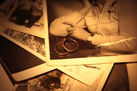 old diary: wedding ring on an old diary and vintage photo