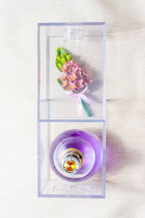 boutonniere: box of wedding accessories with boutonniere, perfumes
