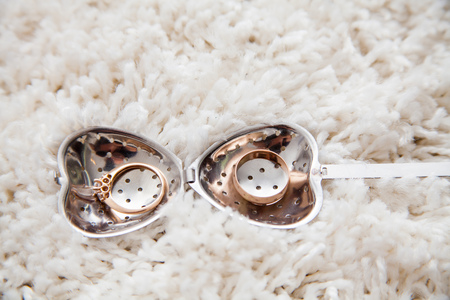 wedding accessories: Male and female wedding accessories with wedding rings.