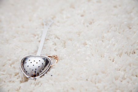 tea filter: spoon, strainer, filter for brewing tea on a white background. isolated, macro Stock Photo