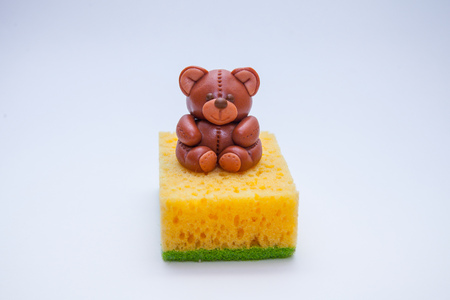 bathtime: pink teddy bear soap with sponge on bathtime