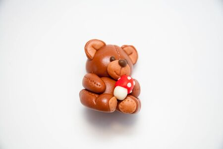 cute love: Plasticine chocolate happy bear with gift holiday boxes on a white background