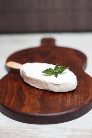 Ice cream bar coated with chocolate on a slate board
