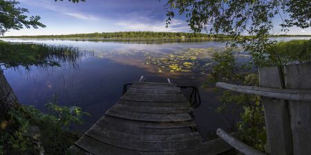 reaches: Panorama of the river in the lower reaches. View from a wooden jetty. Stock Photo