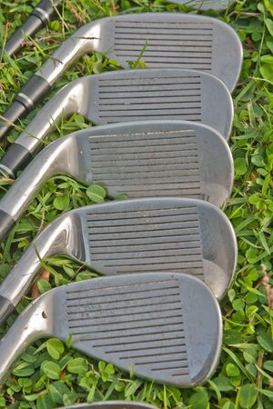 Golf iron set on the grass photo