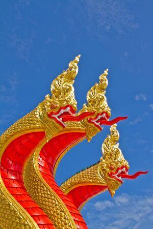 angthong: Photos great Naga head sculpture art Stock Photo