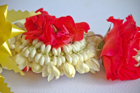 Garland of jasmine flowers - roses photo
