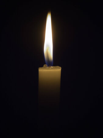 lighting background: Lighting candles with black background