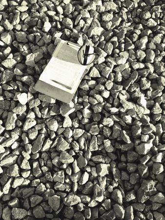 muff: Log sheet and ear muff on the rock. Stock Photo