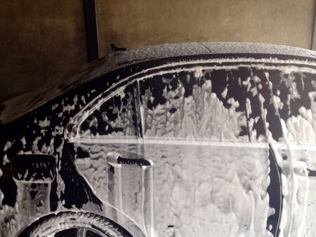 colour: Cleaning the car with foam Stock Photo