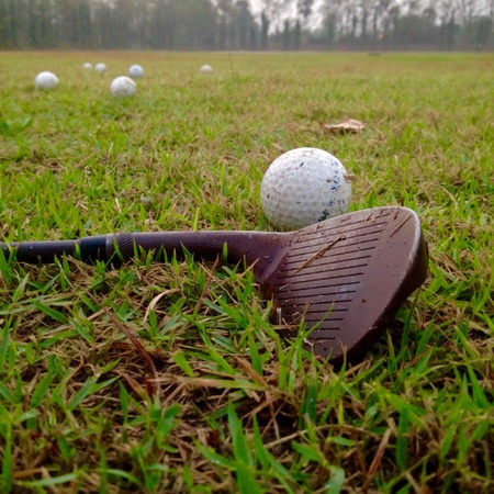 iron: The iron and golf balls on grass Stock Photo