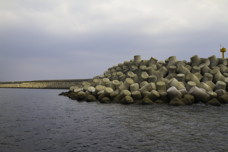 protect: Vertical stones to protect storm the sea