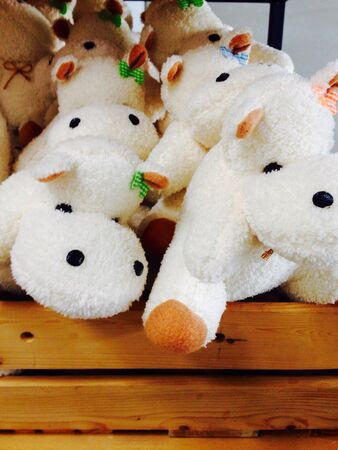 white: Dolls hippo white on wooden floor Stock Photo