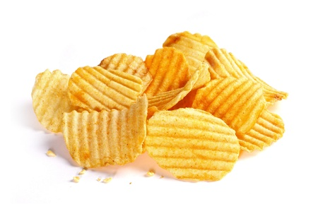 Pile of rippled potato chips on white background Stock Photo