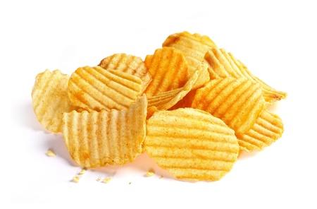 crinkle: Pile of rippled potato chips on white background Stock Photo