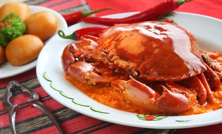 chili sauce: A whole spicy crab delicacy served with fried mantou (chinese steamed buns).