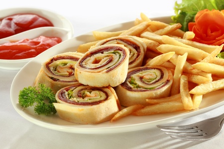 Spiral Sandwich Appetizers with french fries