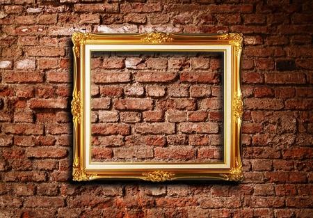 Golden Antique frame on grunge brick wall textured background photo