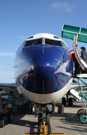 frontal view of passenger airplane in airport photo