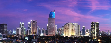 Panoramic cityscape of Indonesia capital city Jakarta at sunset Stock Photo
