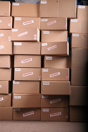 distribution box: Stack of shipping cardboard boxes in a warehouse