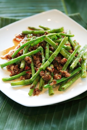 Dried sauteed String Beans stir fried and tossed in garlic sauce Stock Photo