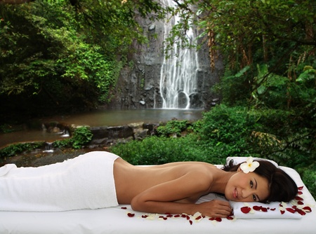 sensual massage: Young woman enjoying day spa in the natural setting