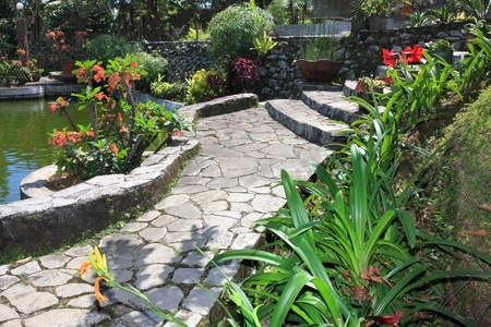 koi fish pond: Natural stone garden with pond