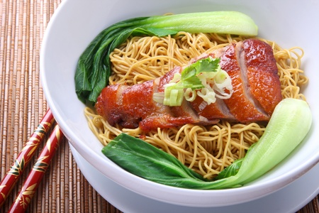 Asian Peking Duck noodle soup Standard-Bild
